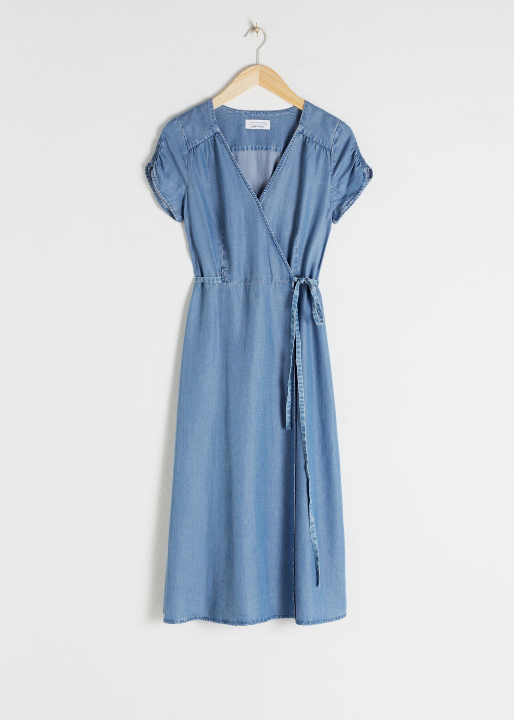 Front image of Stories lyocell denim wrap dress in blue