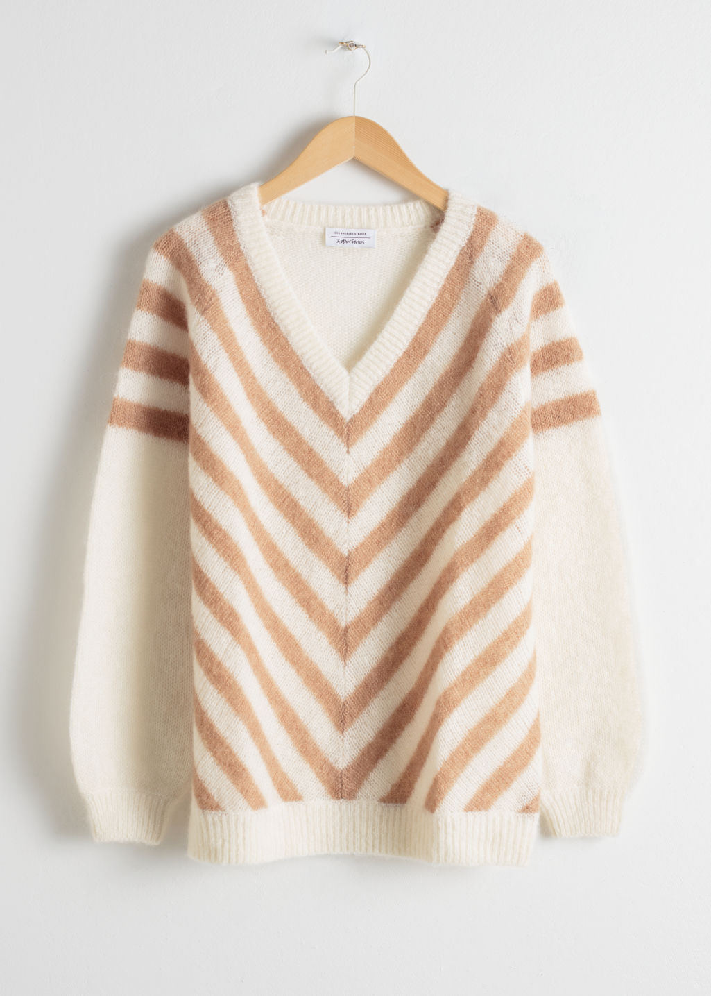 Front image of Stories oversized chevron stripe sweater in white