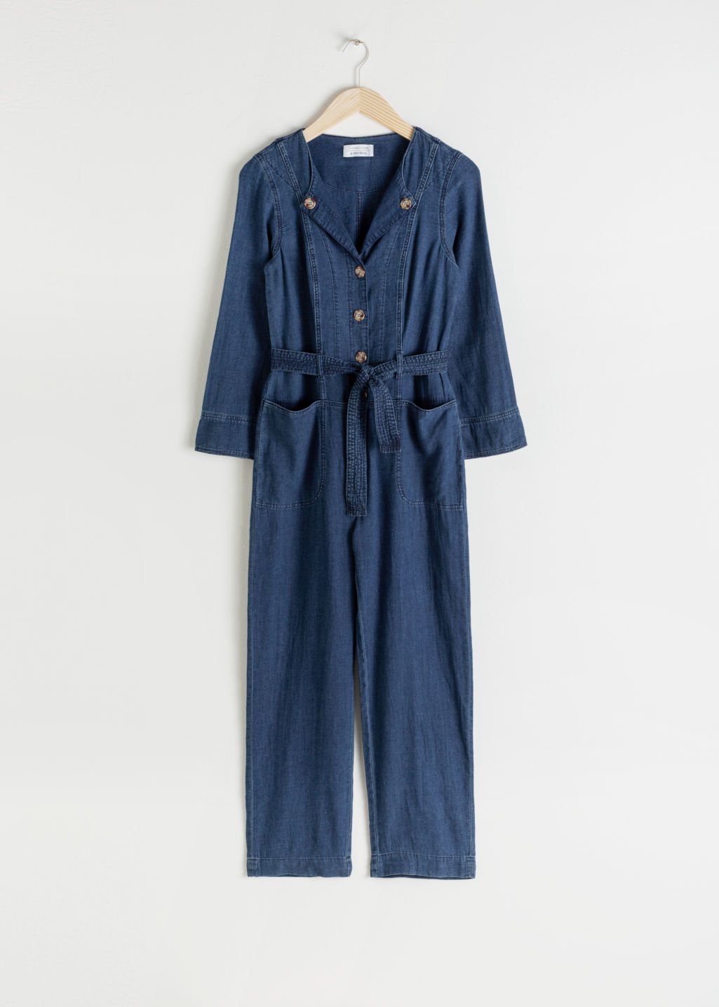 Front image of Stories linen blend denim jumpsuit in blue