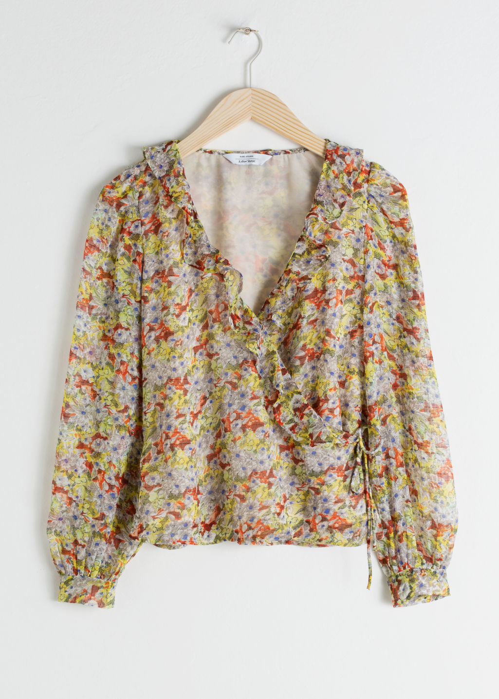 Front image of Stories sheer floral wrap blouse in yellow
