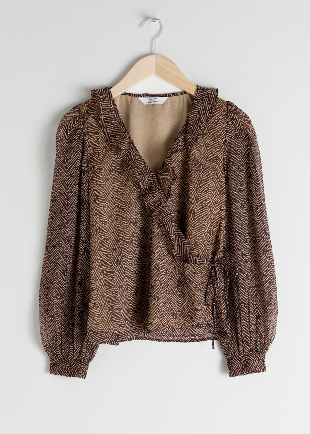 Front image of Stories sheer floral wrap blouse in brown
