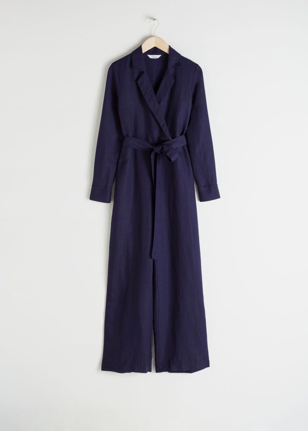 Front image of Stories long sleeve wrap jumpsuit in purple