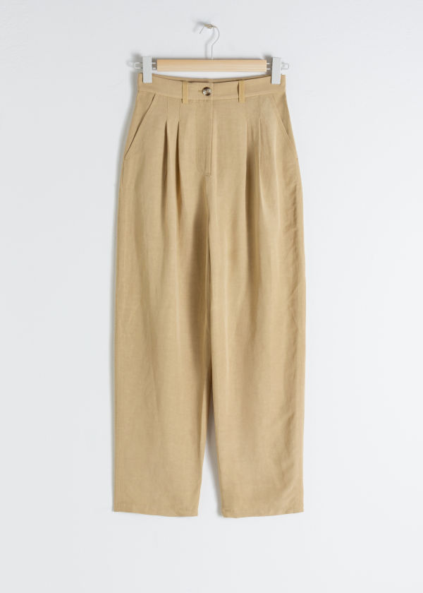 Front image of Stories linen blend plaid trousers in beige