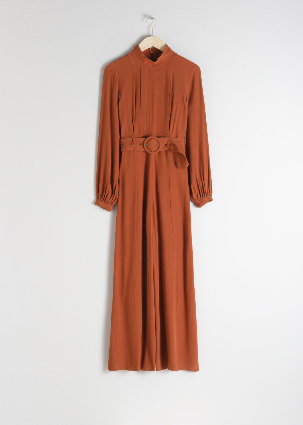 Front image of Stories long sleeve belted jumpsuit in orange