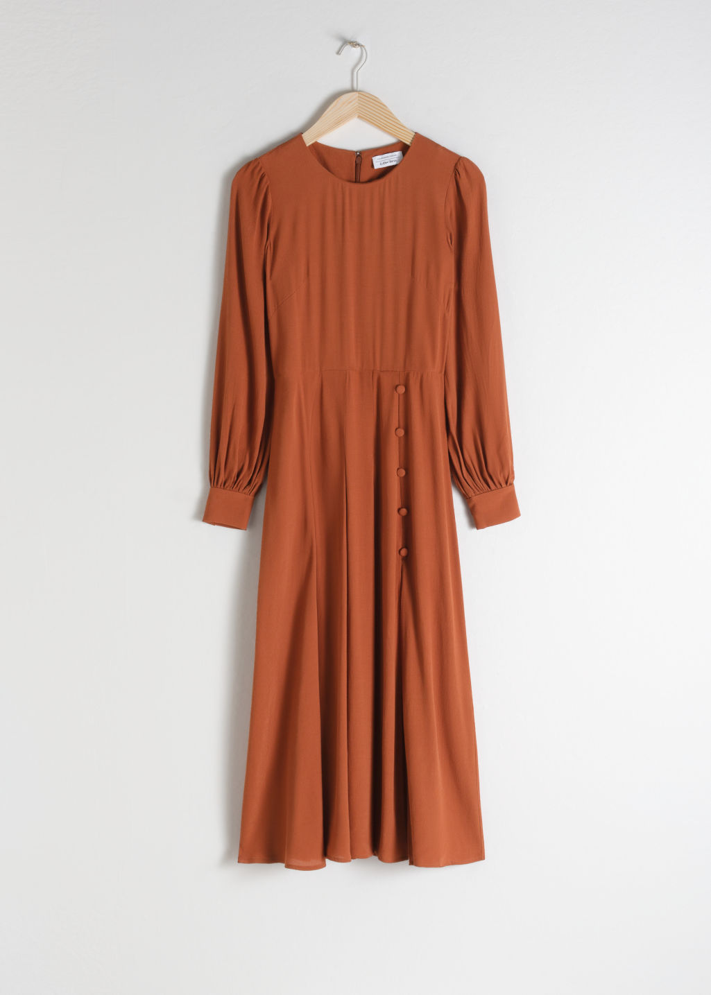 Front image of Stories long sleeve button slit midi dress in orange