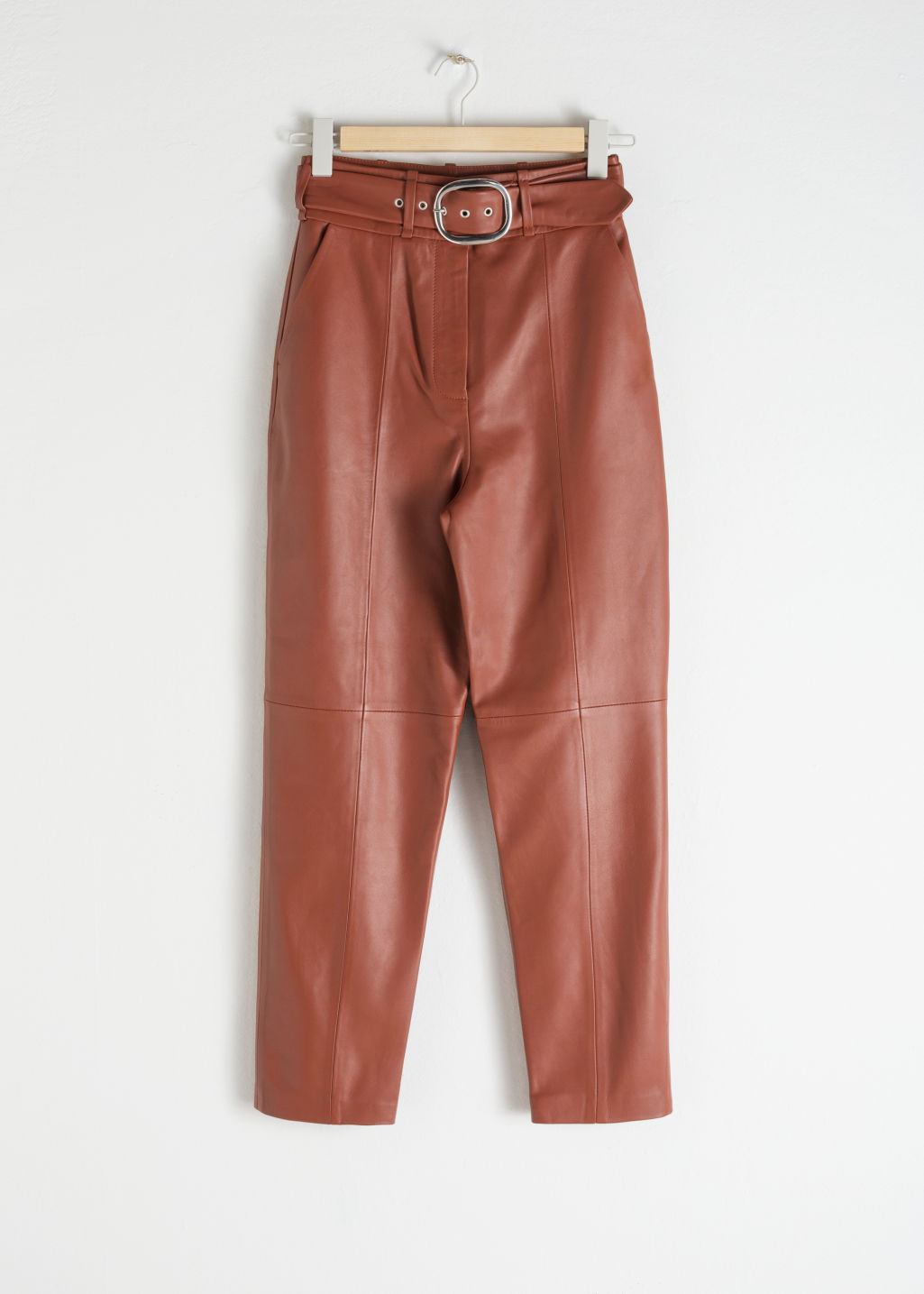 Front image of Stories belted leather trousers in orange