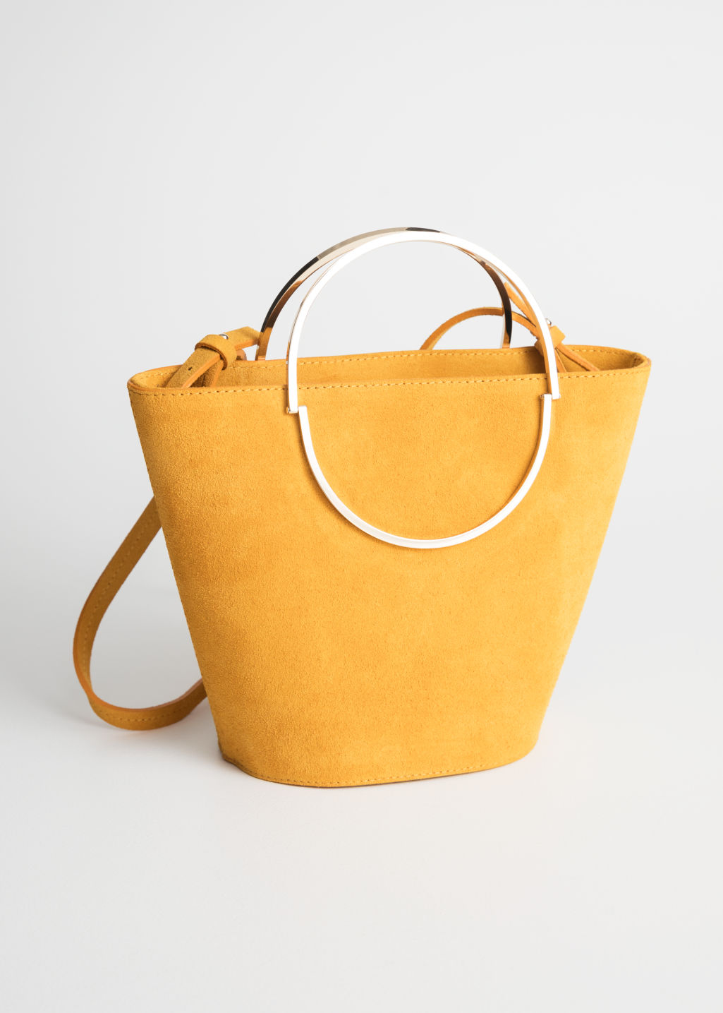 Front image of Stories suede bucket bag in yellow
