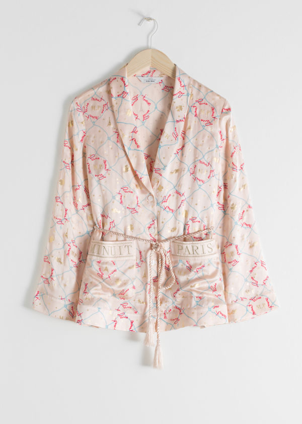 Front image of Stories belted silk lounge shirt in pink