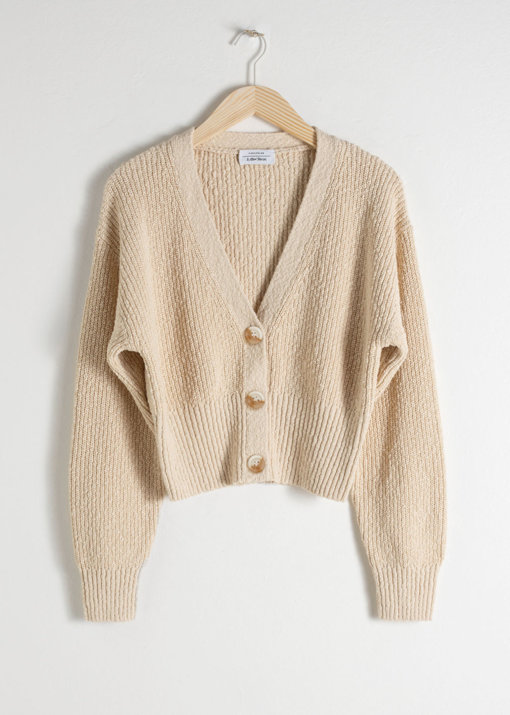Front image of Stories cropped textured cotton cardigan in beige