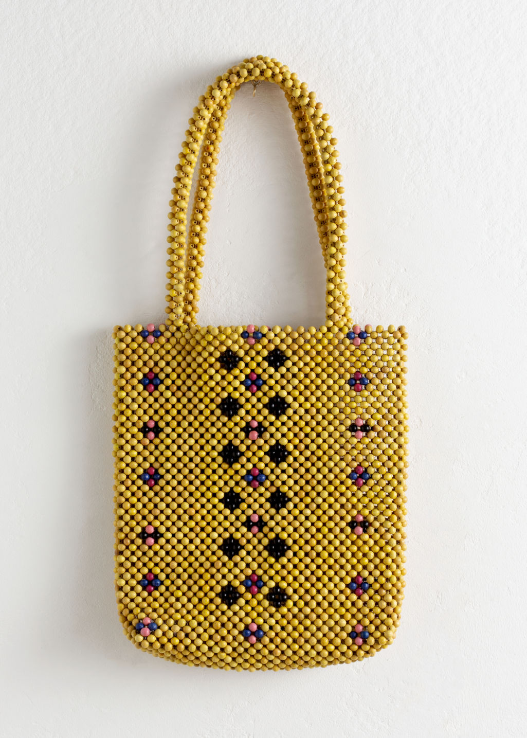 Front image of Stories wooden beaded tote bag in yellow