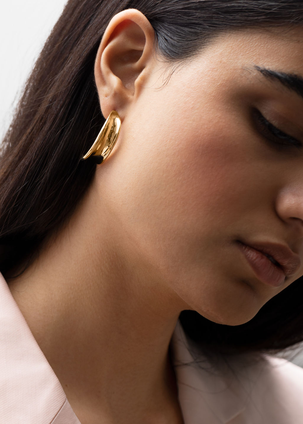 Back image of Stories sculptural hanging earrings in gold