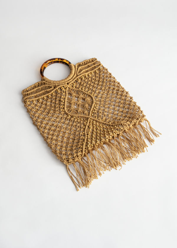Front image of Stories woven jute circle handle tote bag in beige