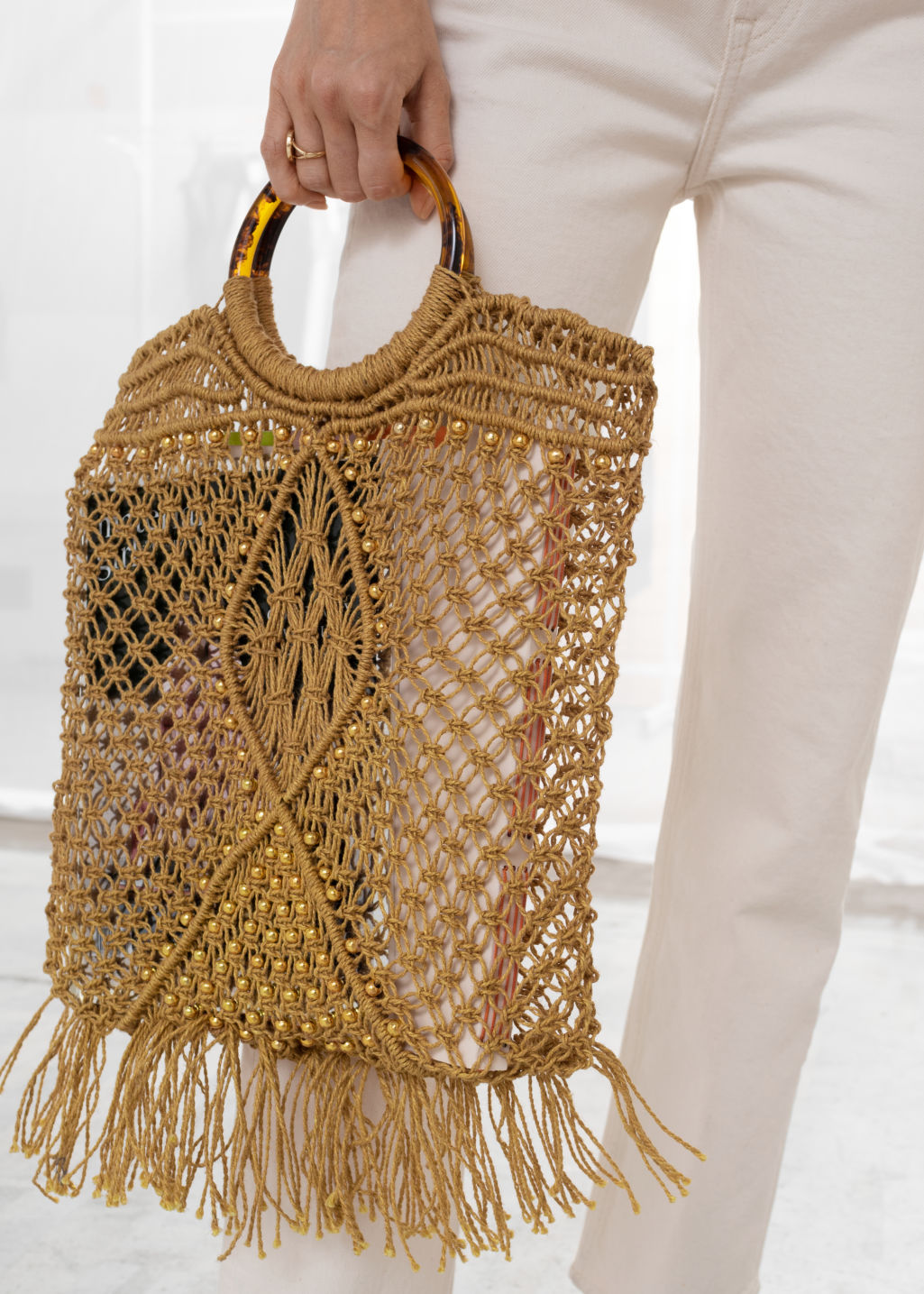 Back image of Stories woven jute circle handle tote bag in beige