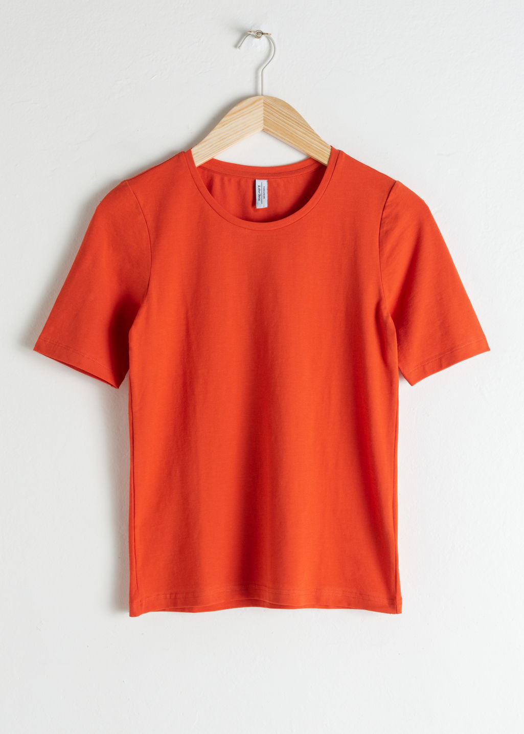 Front image of Stories stretch cotton tee in orange