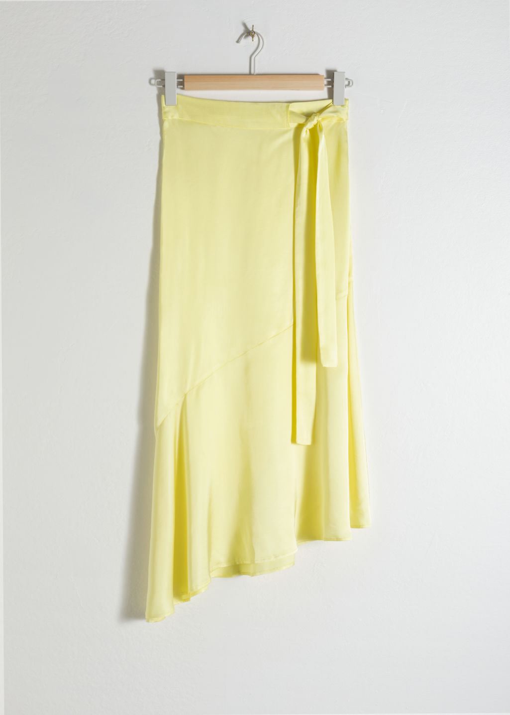 Front image of Stories asymmetric satin midi skirt in yellow