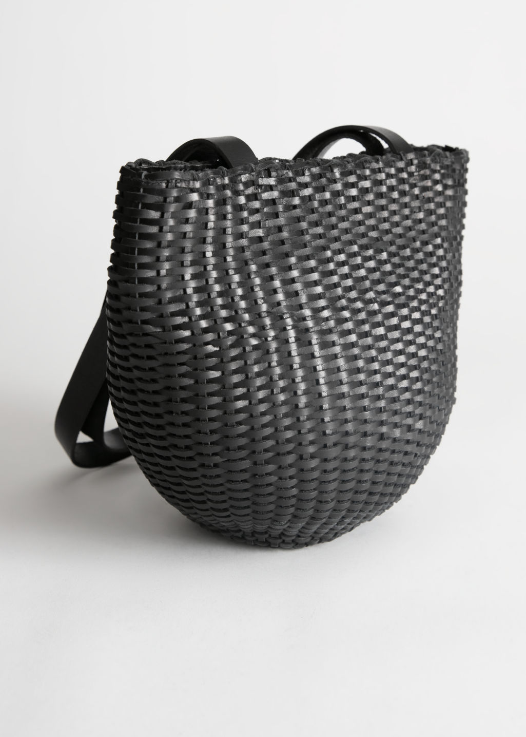 Front image of Stories woven leather bucket bag in black