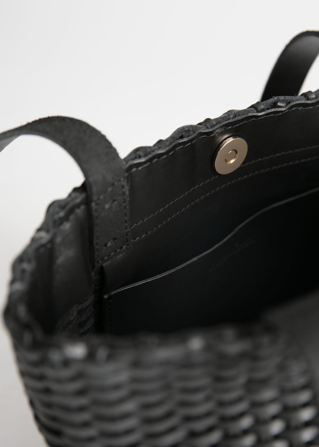 Back image of Stories woven leather bucket bag in black