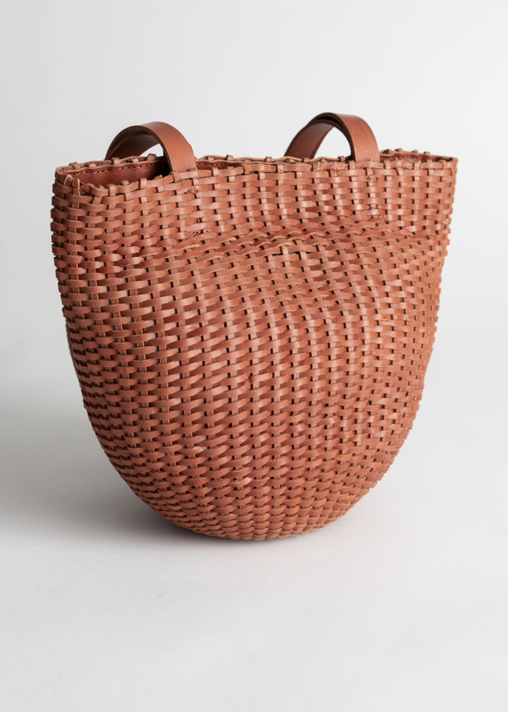 Front image of Stories woven leather bucket bag in beige