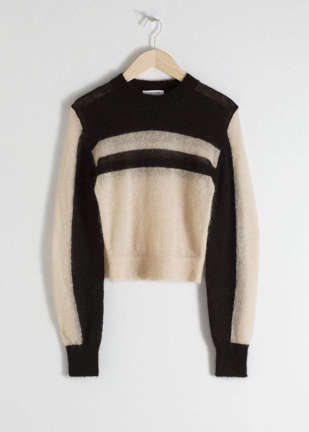 Front image of Stories cropped striped sweater in black