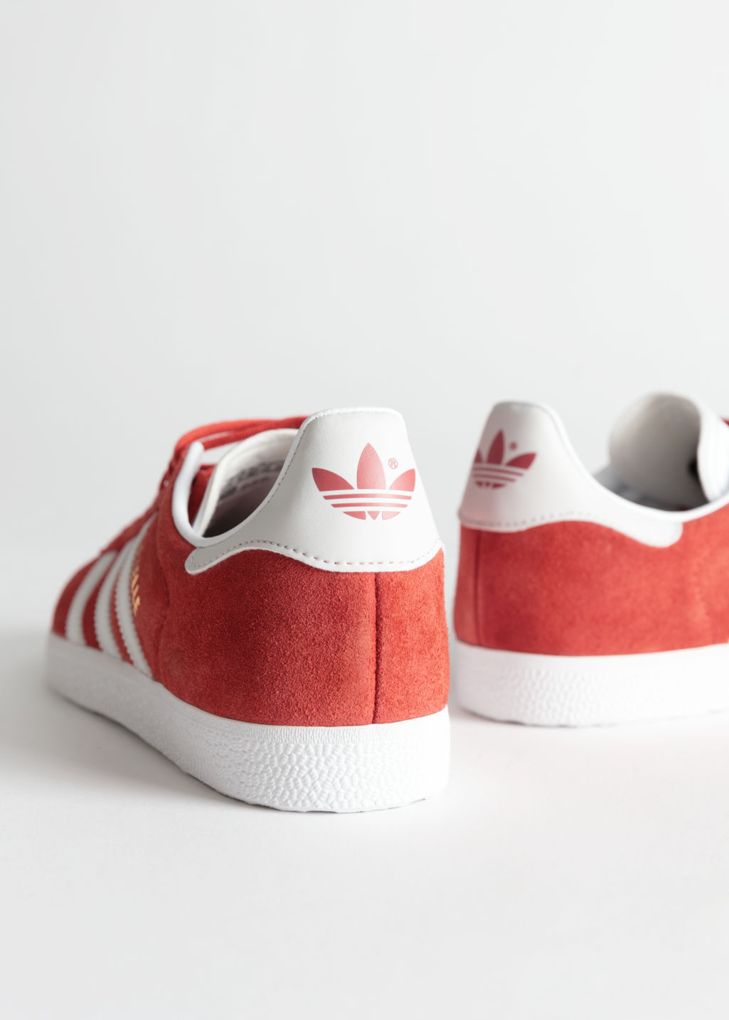 Back image of Stories adidas gazelle in orange