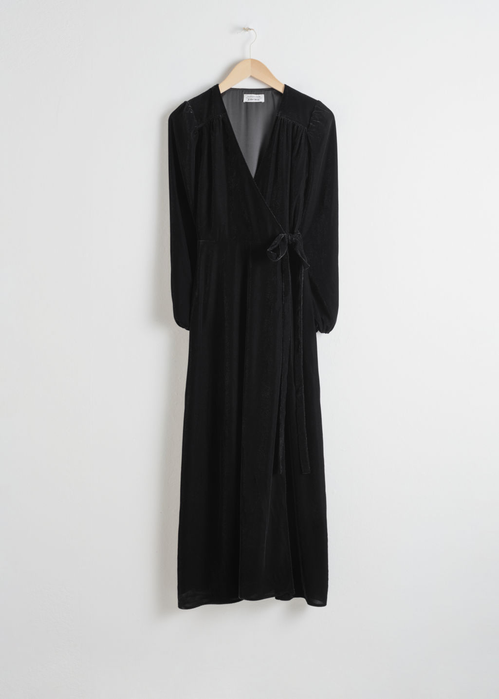 Front image of Stories velvet midi wrap dress in black
