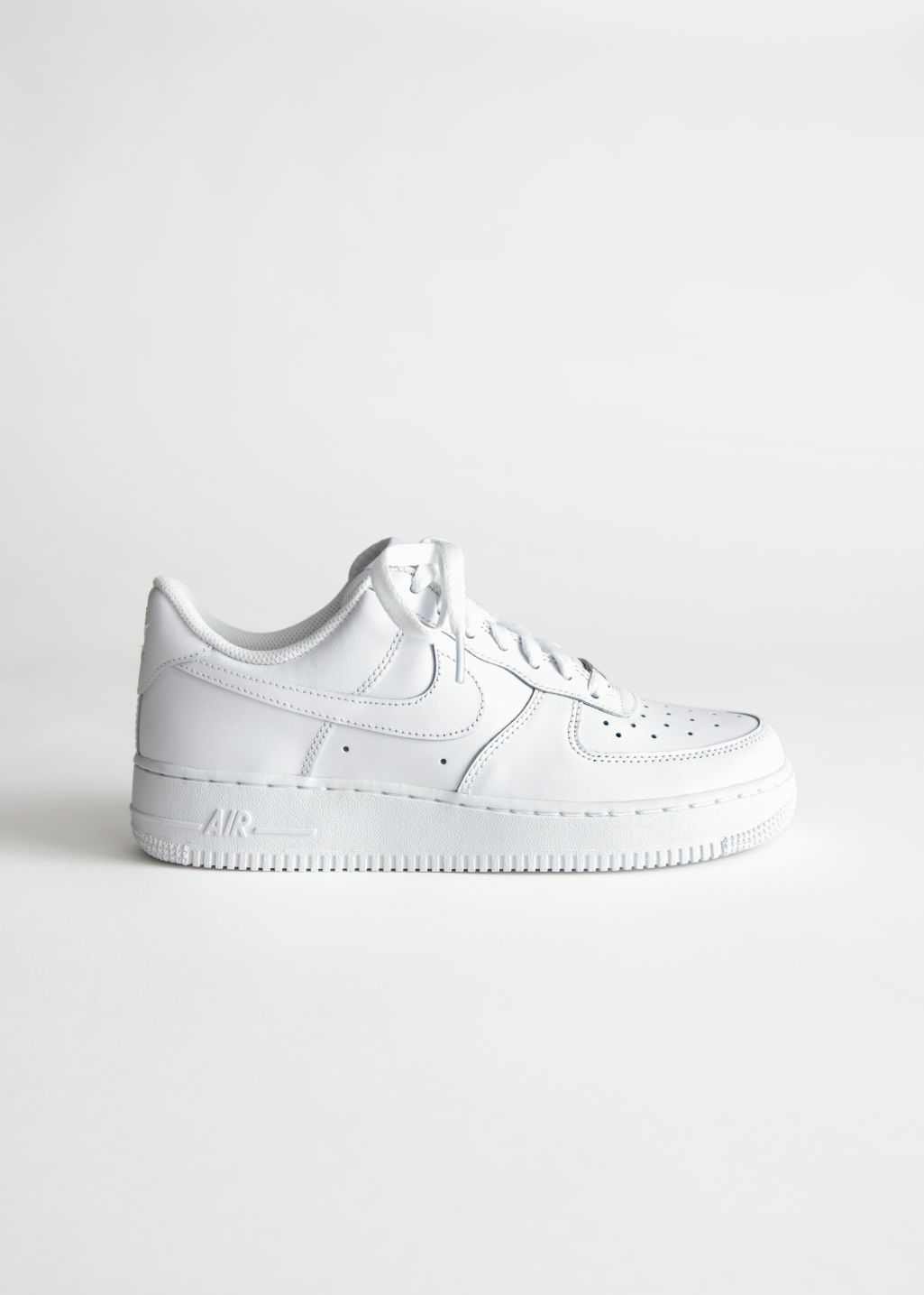 Front image of Stories nike air force 1 in white