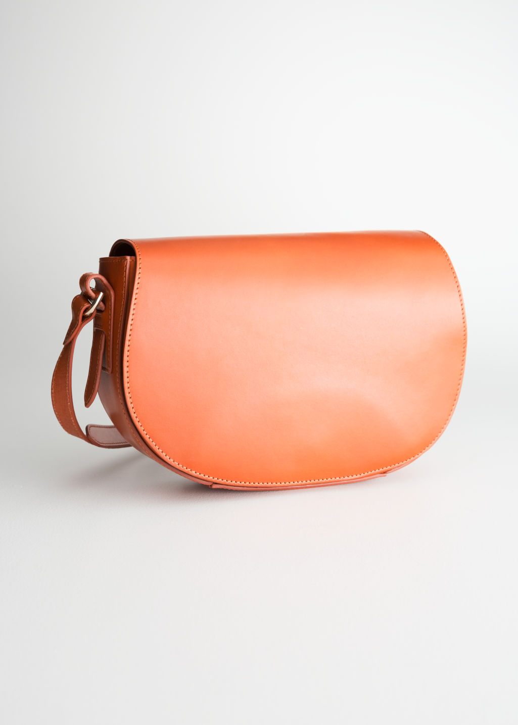 Front image of Stories leather crossbody saddle bag in yellow