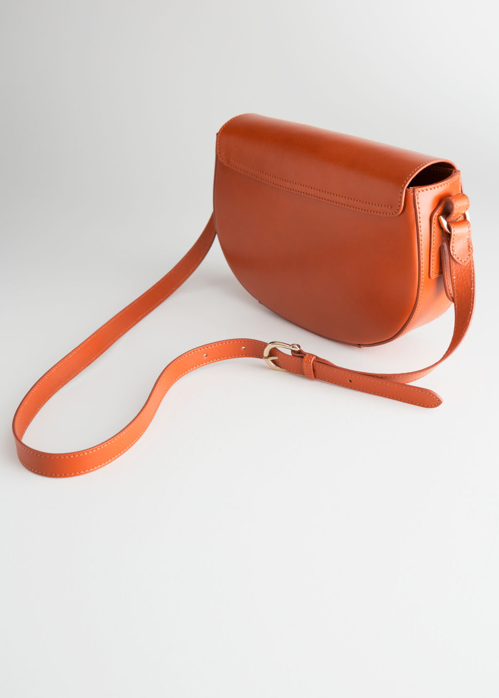 Back image of Stories leather crossbody saddle bag in yellow