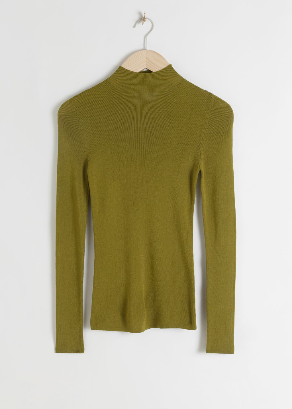 Front image of Stories fitted micro knit turtleneck in green