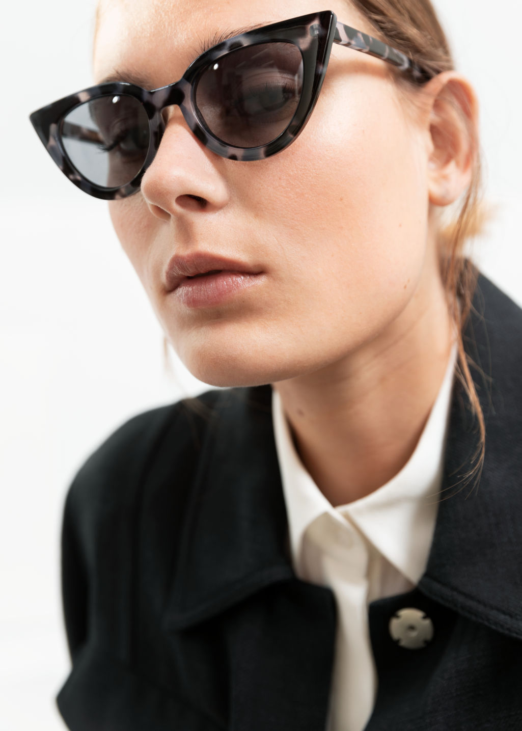 Front image of Stories cat eye sunglasses in black
