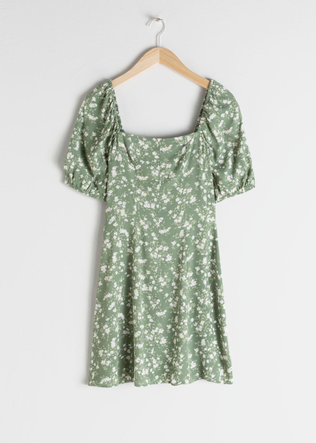 Front image of Stories puff sleeve mini dress in green