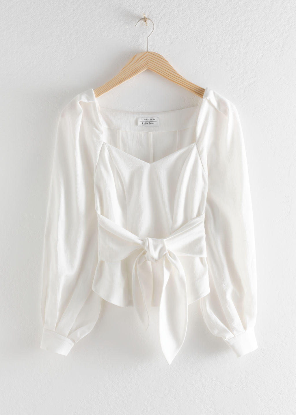 Front image of Stories tie waist blouse in white