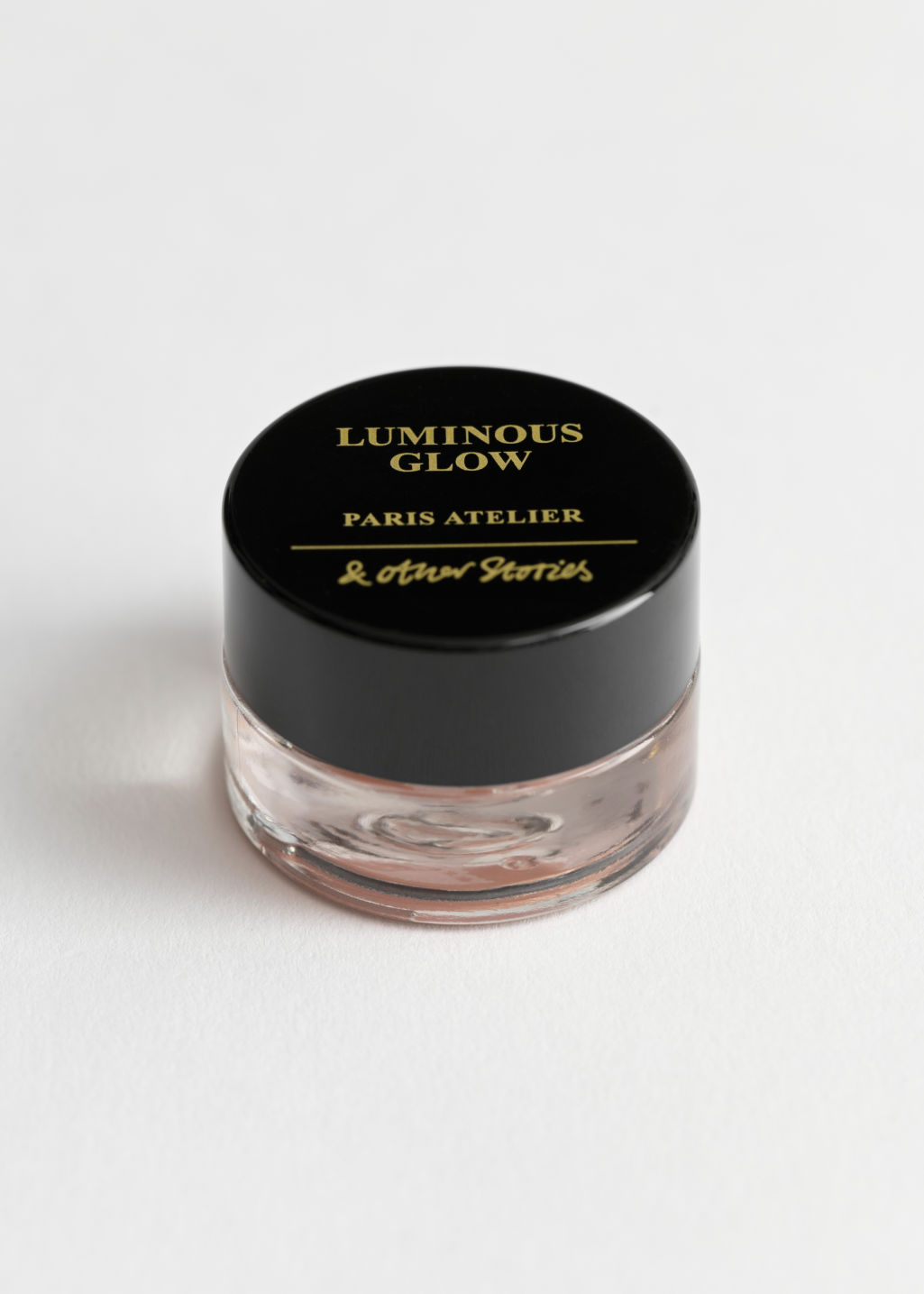 Front image of Stories luminous glow highlighter in orange