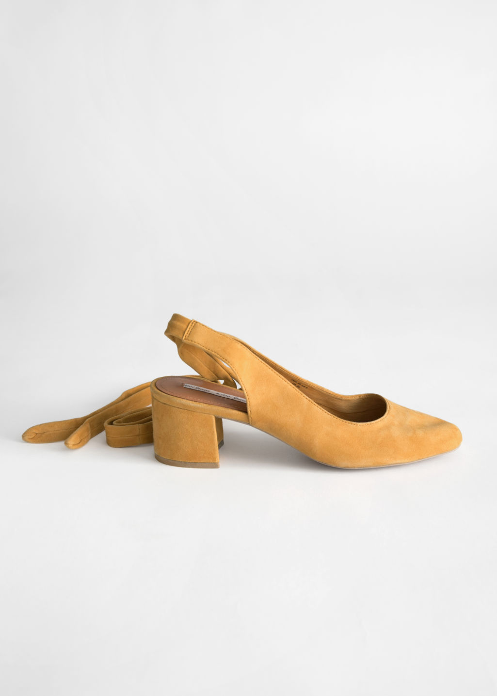 Back image of Stories suede lace up slingback pumps in yellow