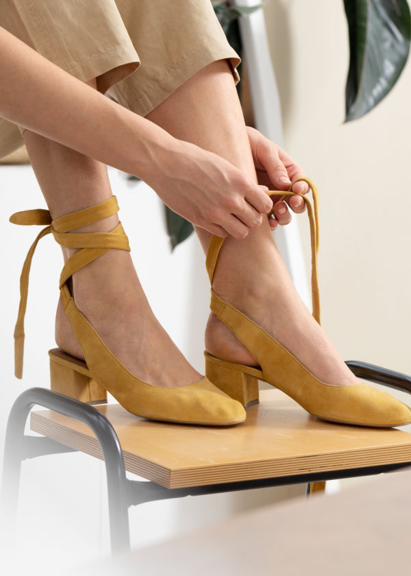 Front image of Stories suede lace up slingback pumps in yellow