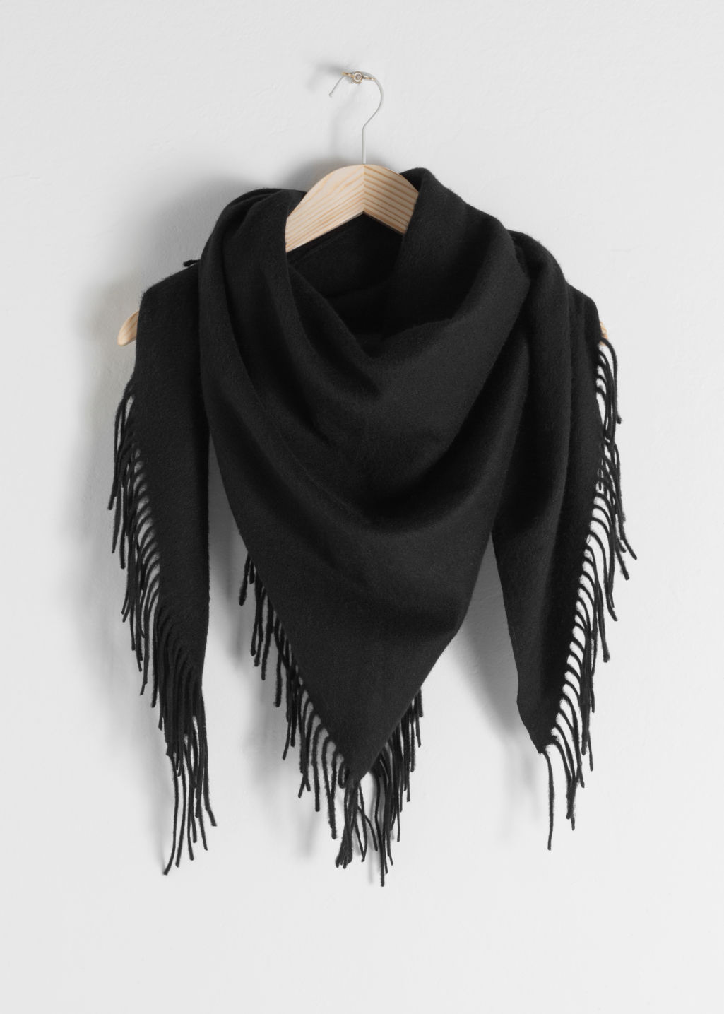 Front image of Stories fringe wool triangle scarf in black