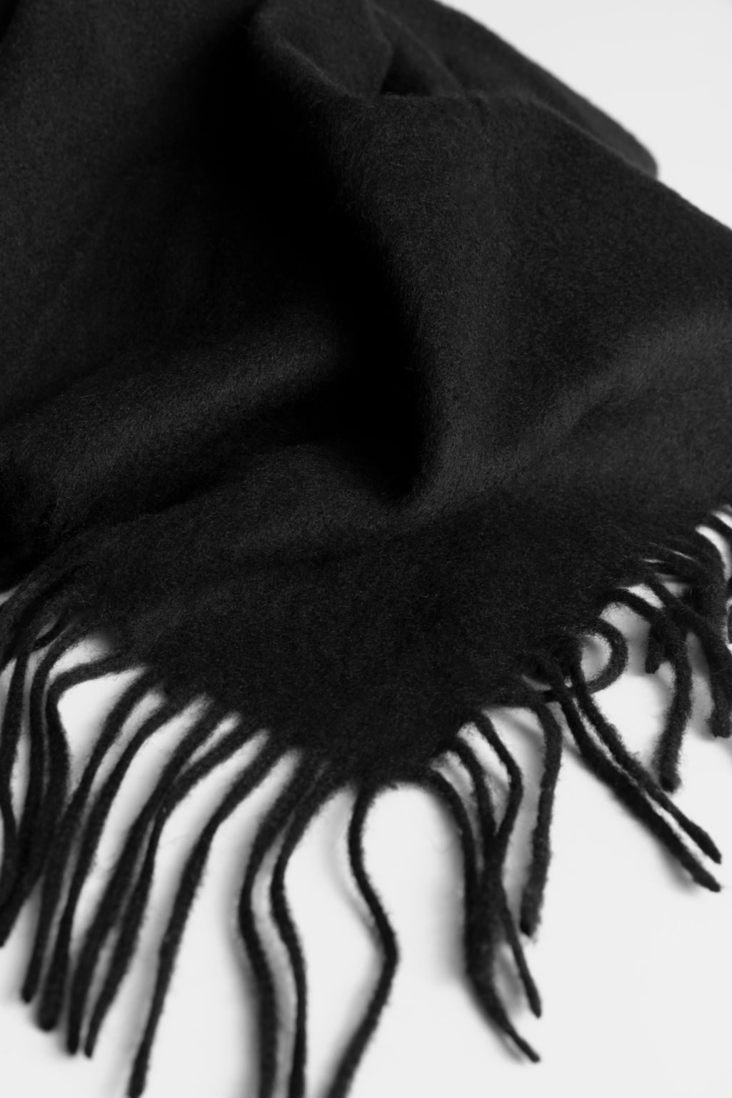 Back image of Stories fringe wool triangle scarf in black