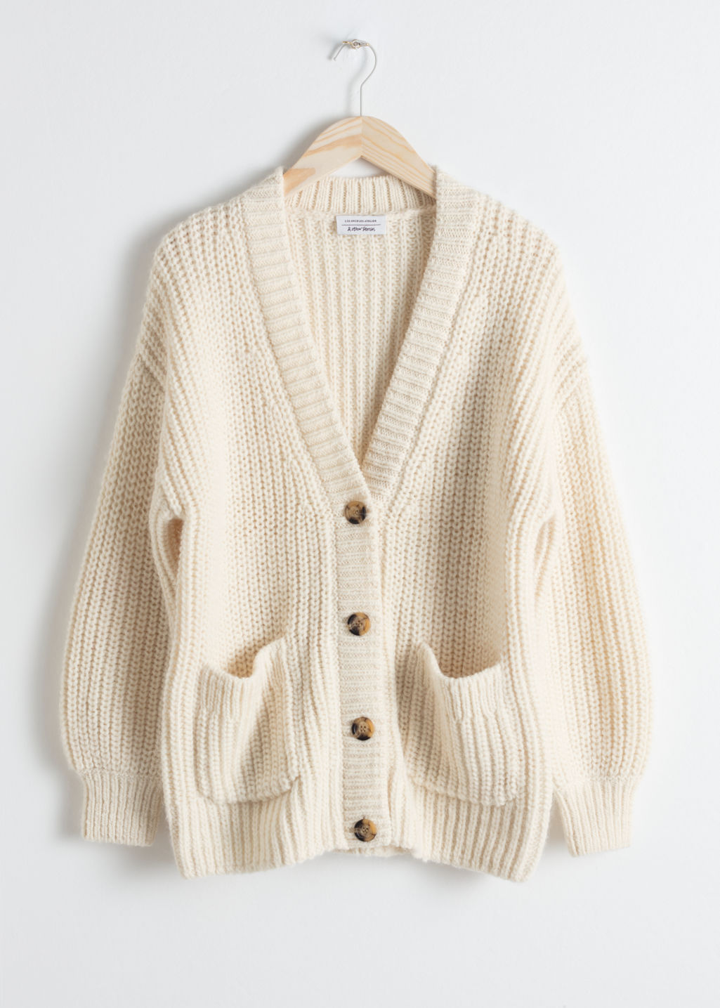 Front image of Stories overzied rib knit cardigan in white