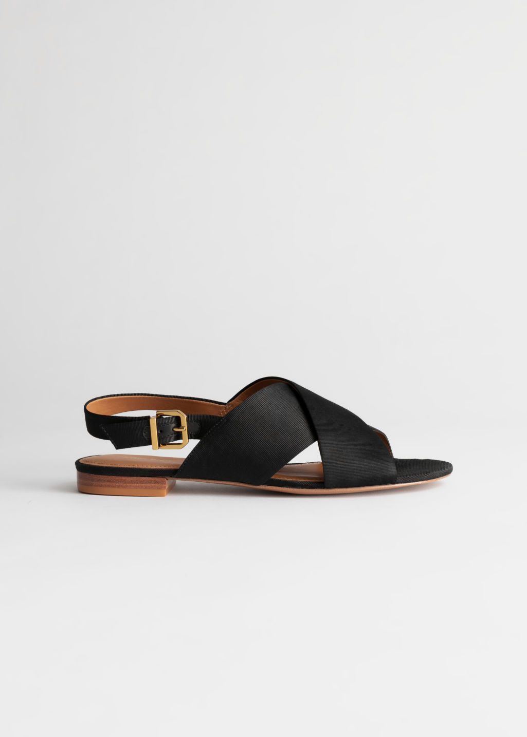 StillLife Front Image of Stories Criss Cross Slingback Sandals in Black