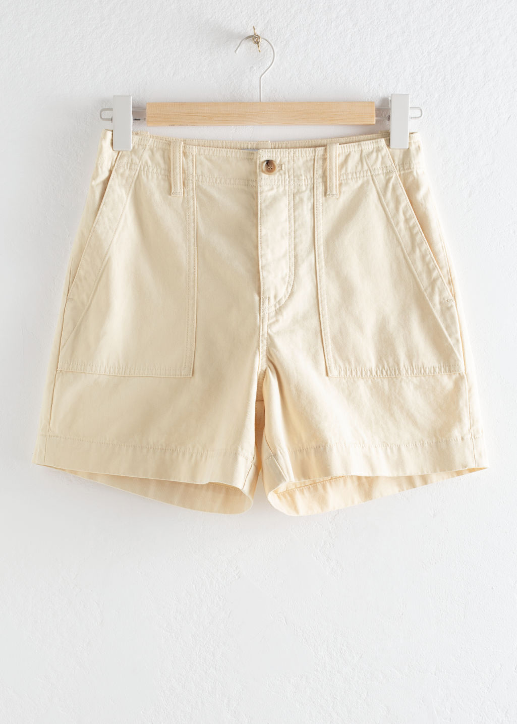 Front image of Stories cotton blend shorts in beige