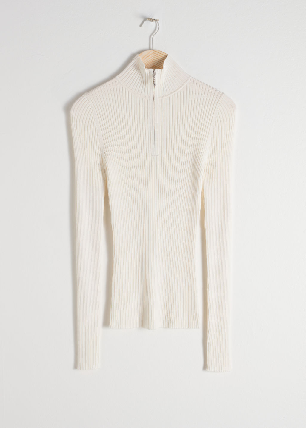 Front image of Stories zippered rib knit turtleneck in white