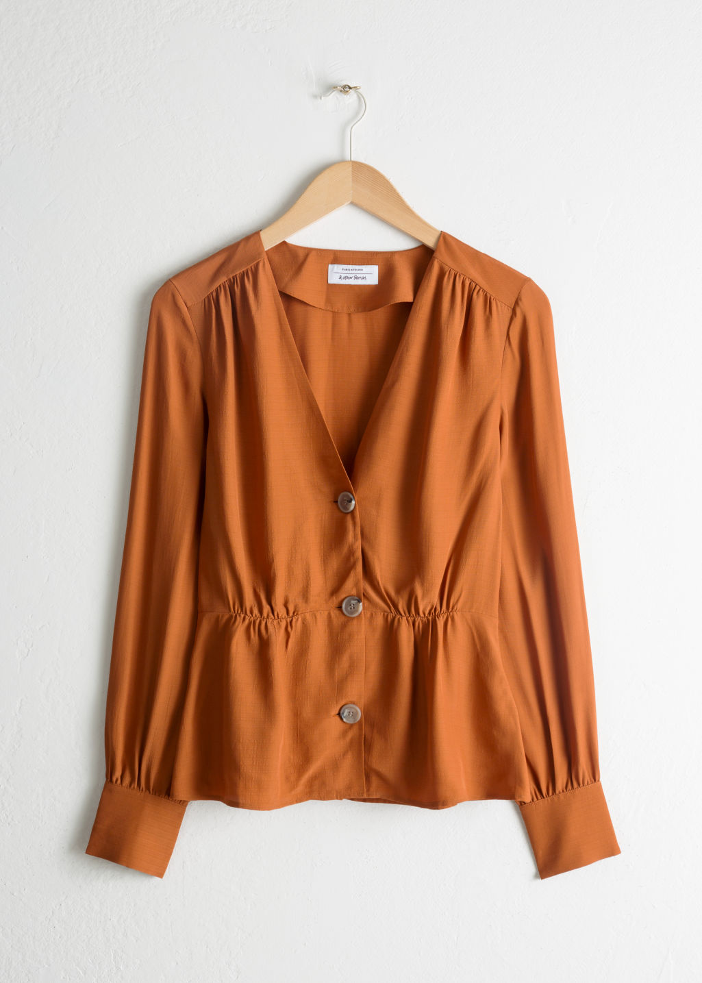 Front image of Stories v-cut button up blouse in orange