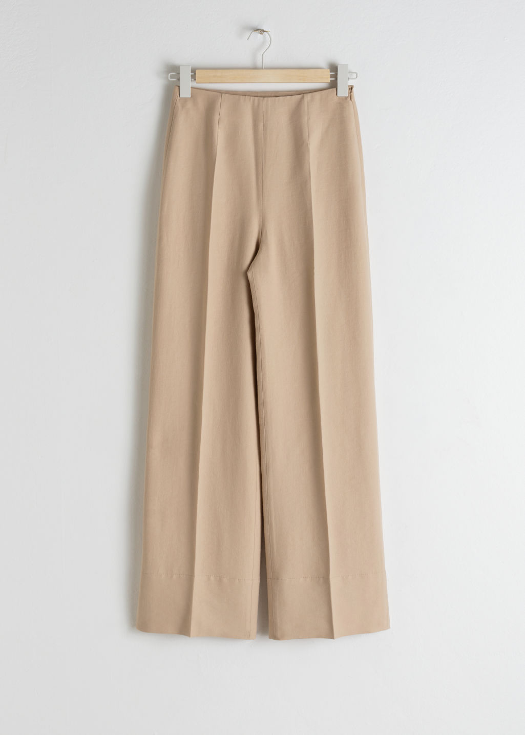 Front image of Stories wide lyocell blend trousers in beige