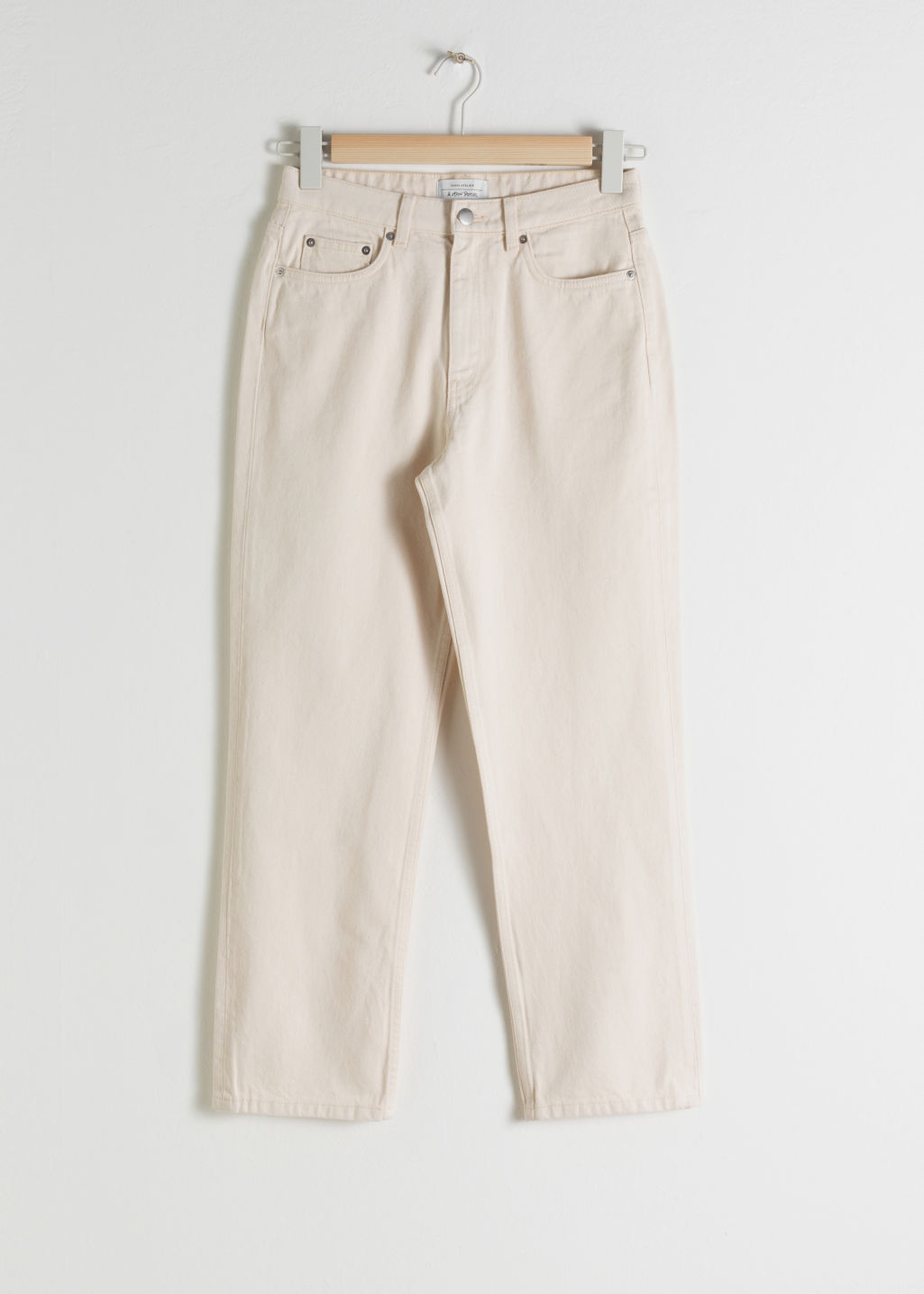 Front image of Stories tapered mid rise jeans in white
