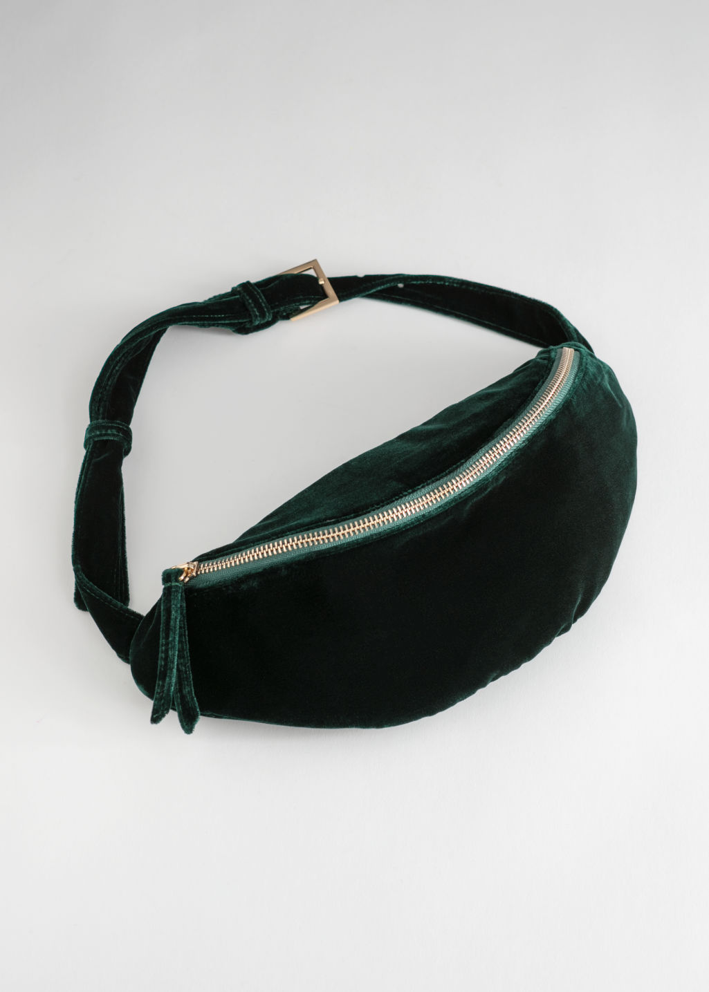 Front image of Stories velvet zippered beltbag  in green