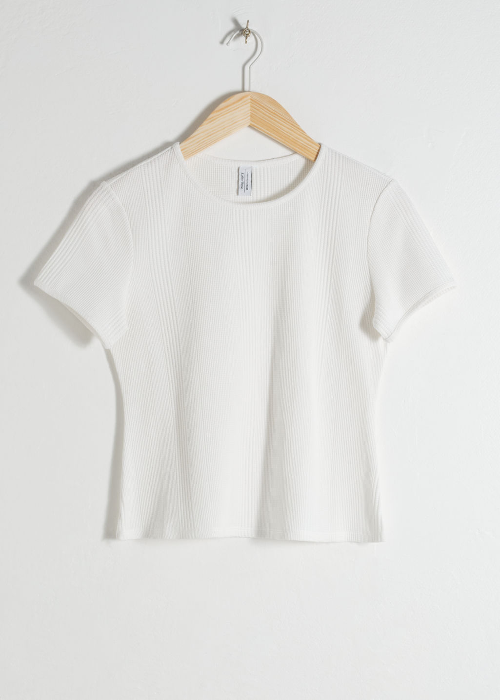 Front image of Stories crewneck cotton tee in white