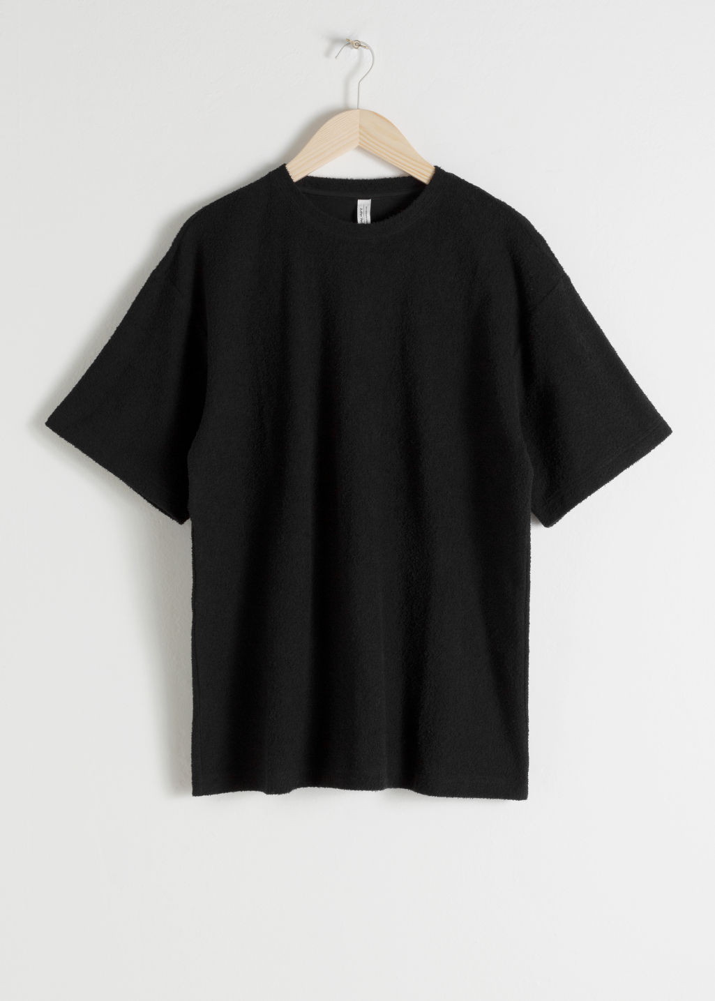 Front image of Stories oversized cotton tee in black