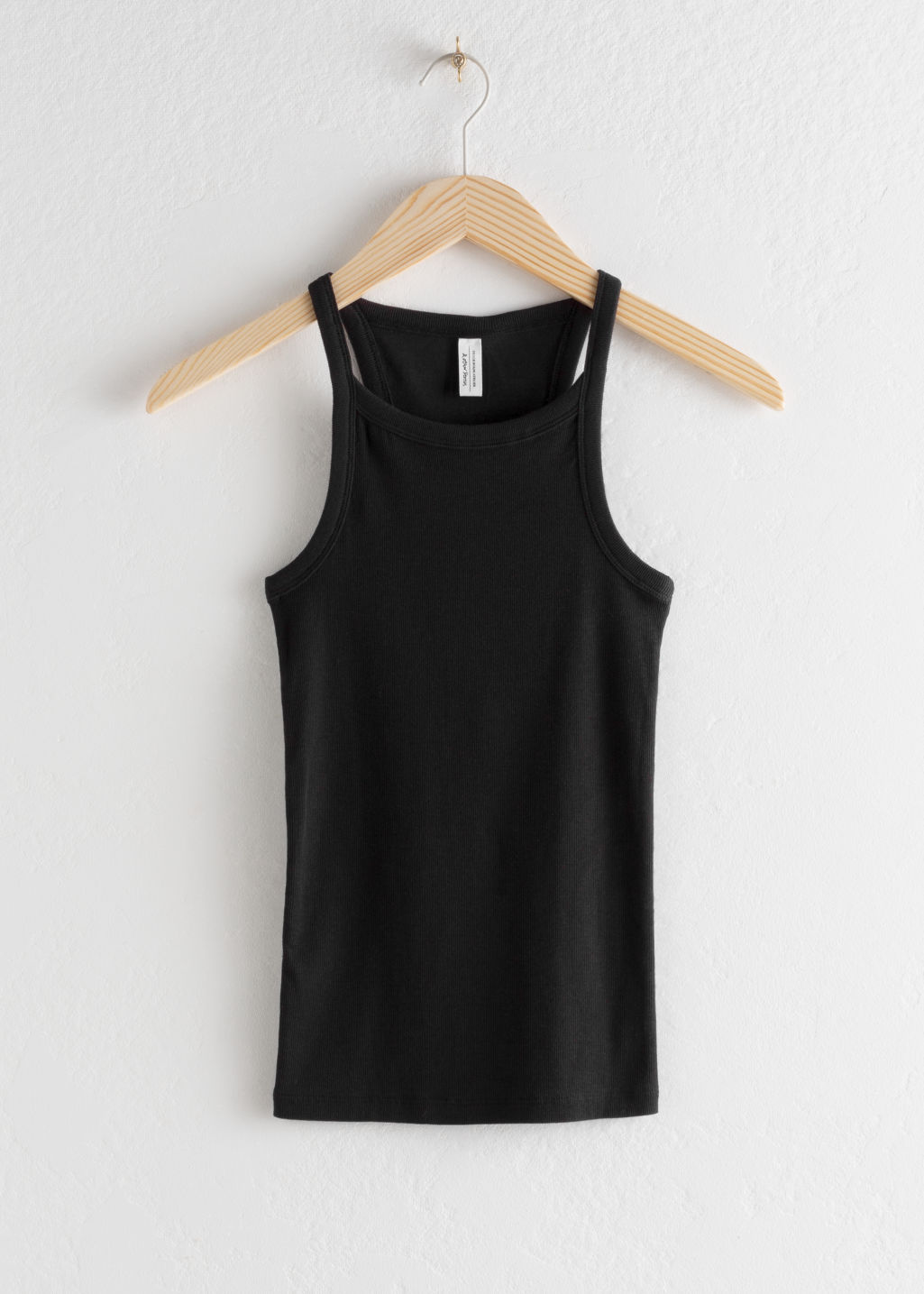 Front image of Stories racer cut cotton tank top in black