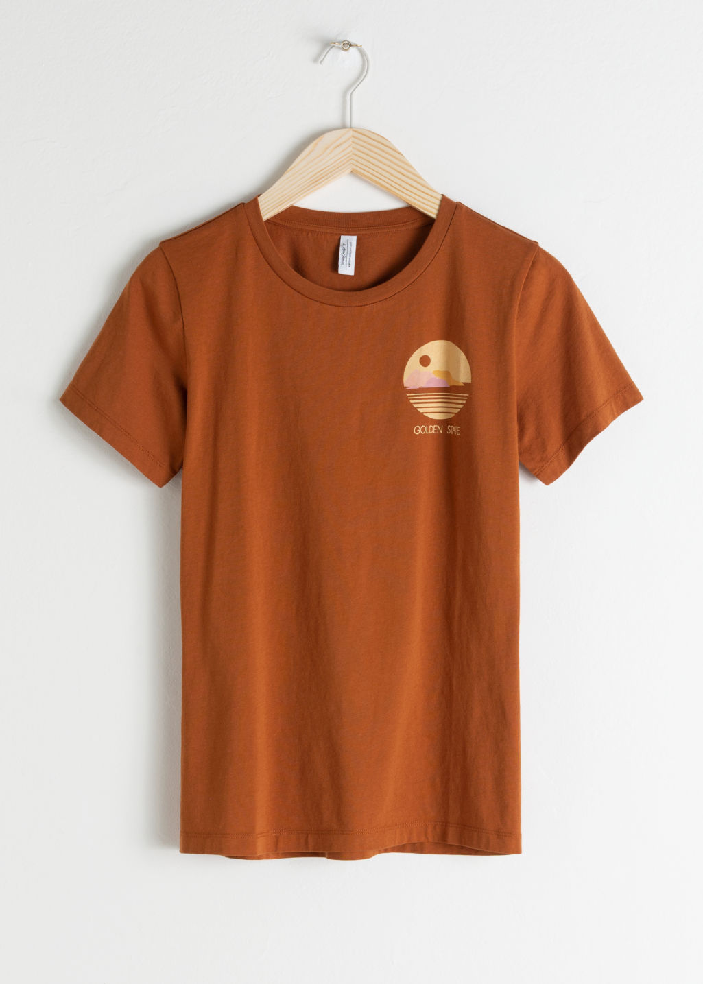 Front image of Stories sunset graphic tee in orange