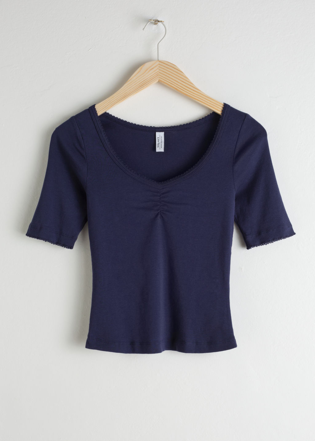 Front image of Stories fitted crop top in blue